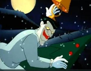 The Joker, riding a rocket shaped like a Christmas tree, waves goodbye.